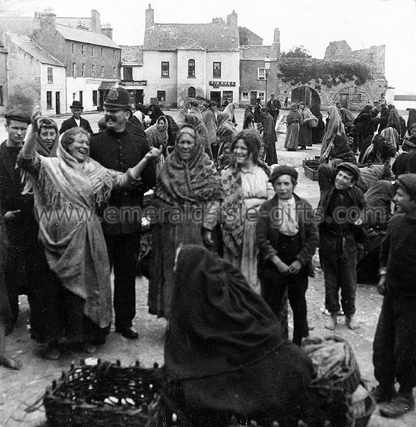 A lighthearted moment on market day in 1903 (even the policeman joins in)